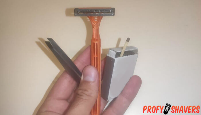 taking a blade out of a disposable razor